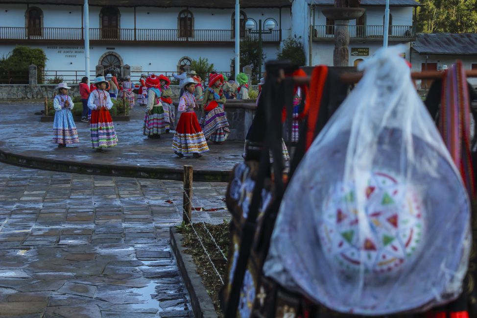 Local residents perform during the early morning hours at a small colonial village in Colca Canyon, Peru.